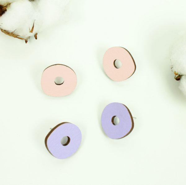 pienet pastellinpinkit ja liilat ympyrät